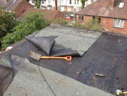 Remove damaged roofing felt