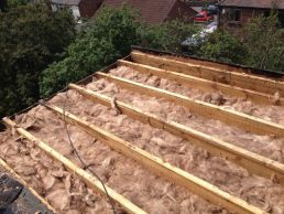 Insulation between roof timbers